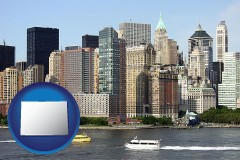 colorado map icon and a New York City ferry and water taxi on the Hudson River