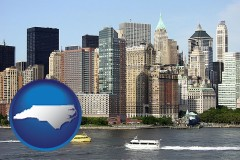 north-carolina map icon and a New York City ferry and water taxi on the Hudson River