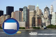 south-dakota map icon and a New York City ferry and water taxi on the Hudson River