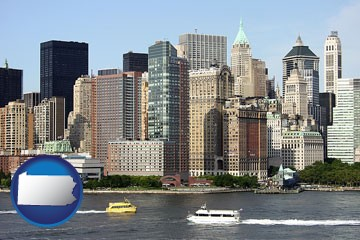 a New York City ferry and water taxi on the Hudson River - with Pennsylvania icon